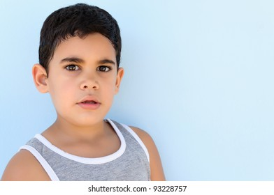 Adorable latin child with a thoughtful expression
