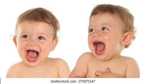 Adorable laughing ten month old baby boy twins.