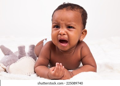 Adorable little african american baby girl crying - Black people