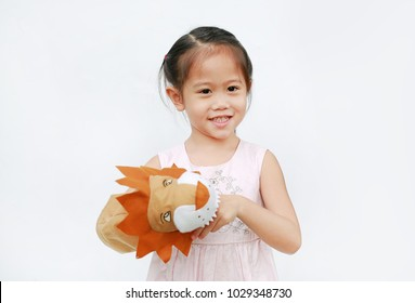 Adorable little Asian child girl hand wear and playing Lion puppets on white background.