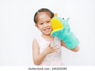 Adorable little Asian child girl hand wear and playing Rhinoceros puppets on white background.