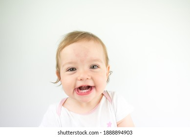 adorable little baby girl on white background smile and look at the camera. happy kids face.