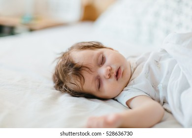 Adorable little baby girl sleeping and having a dream