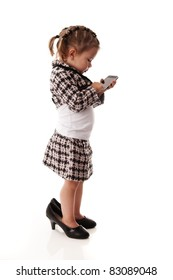 Adorable little baby girl talking on a phone