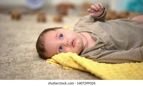 Adorable little baby lying, birth statistics and governmental children aid
