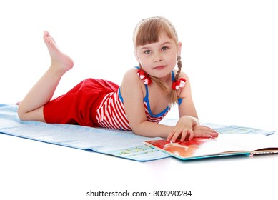Adorable little blonde girl with braided pigtails on her head,in a red swimsuit sunbathing on a towel and reading a book-Isolated on white background