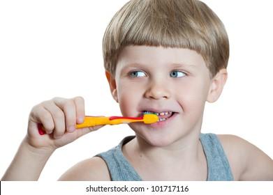 an adorable little boy brushing his teeth