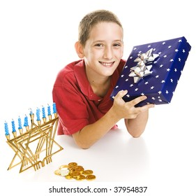 Adorable little boy with a Chanukah gift, menorah, dreidel and gelt.  Isolated on white.