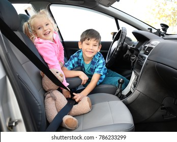 Adorable little boy and girl in car