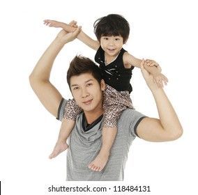 Adorable little boy having fun with his father posing