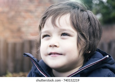 Adorable little boy  looking up to the sky with smiling face in retro tone, Portrait of toddler with dramatic colour, Happy or Healthy  Child concept
