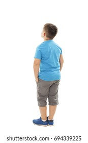 Adorable little boy looking at wall. Rear view, Isolated on white background