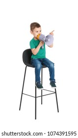 Adorable little boy with megaphone on white background