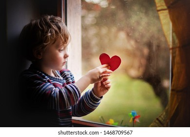 adorable little boy with a paper heart