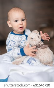 adorable little boy playing with teddy bear toy
