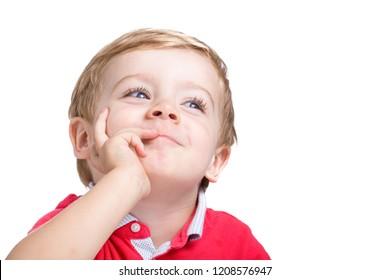 Adorable little boy thinking on white background