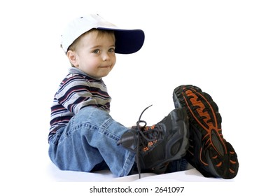Adorable little boy in a very big shoes