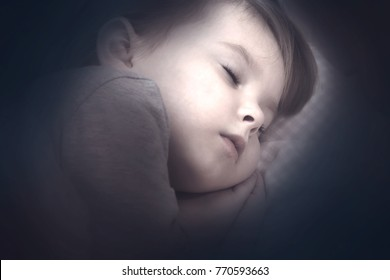 Adorable little child girl sleeping in the bed. Toned