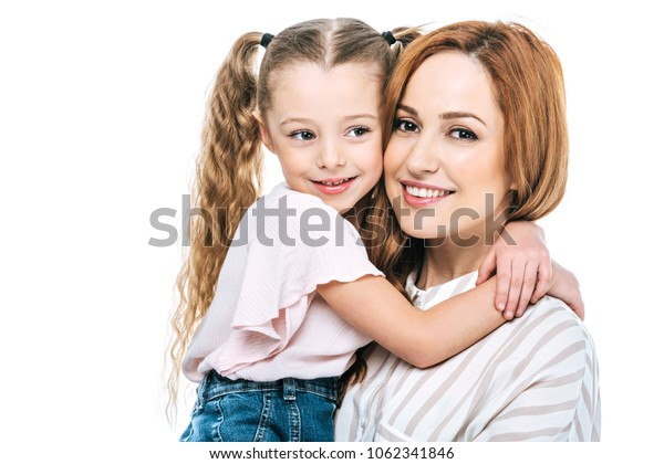 adorable little child hugging happy mother isolated on white