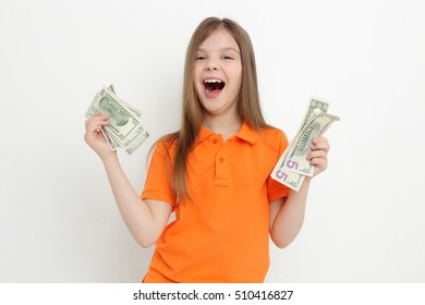 Adorable little girl with cash money dollars USA