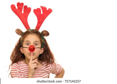Adorable little girl dressed as Rudolph the reindeer shushing to the camera isolated copyspace antlers nose costume children kids quiet secret x-mas presents merry new year holidays family