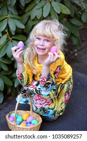 Adorable little girl with Easter eggs