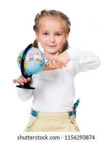 Adorable little girl with globe isolated on a white background