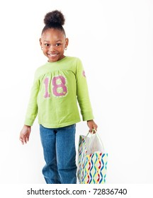 Adorable little girl with her shopping bag