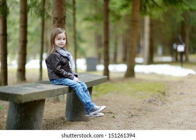 Adorable little girl hiking in the forest on summer day