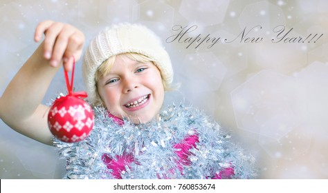 Adorable little girl holding Christmas ornament