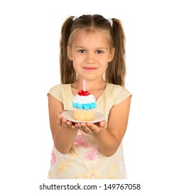 An adorable little girl holds a cupcake with a small anniversary candle, isolated