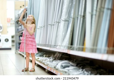 Adorable little girl in a houseware store