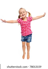 adorable little girl jumps in studio, having fun, isolated on white.