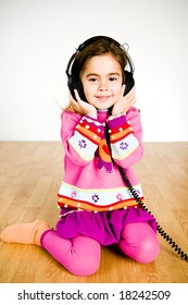 adorable little girl listening to music