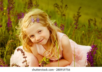 adorable little girl with long blond hair portrait