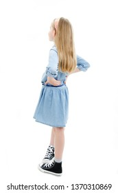 Adorable little girl looking at wall. Back view. Isolated on white background