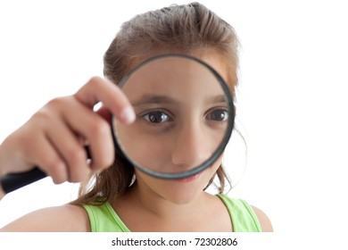 Adorable little girl with a magnifying glass isolated on a white background