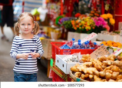 Adorable little girl at market in Hong Kong
