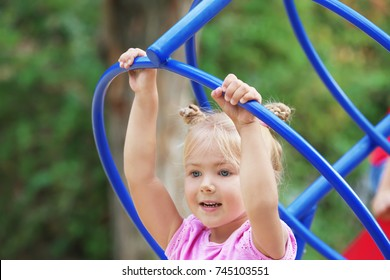 Adorable little girl on playground