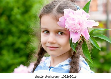 Adorable little girl outdoor with flower in her hair