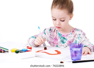 Adorable little girl painting with brush
