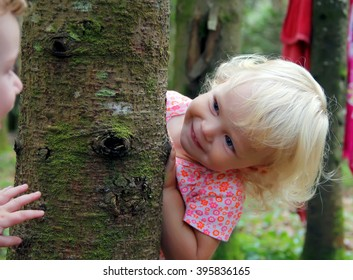 Adorable little girl playing peekaboo
