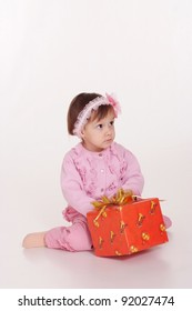 Adorable little girl with red gift box