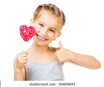Adorable little girl with red lollipop in heart shape isolated over white background