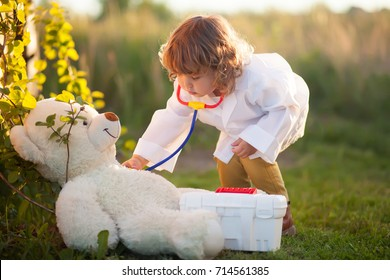 Adorable little girl role playing. little doctor. active play outdoors, beautiful sunset light