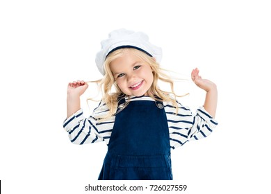 adorable little girl in sailor costume smiling at camera isolated on white