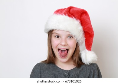 Adorable little girl in santa hat