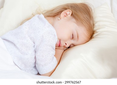 Adorable little girl sleep in the bed