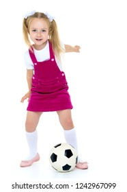 Adorable little girl with a soccer ball. The concept of children's sports, summer outdoor recreation. Isolated on white background.