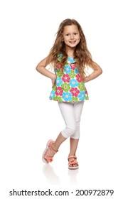 Adorable little girl standing in full length over white background